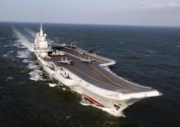 The Liaoning, China's only aircraft carrier, sails during military drills in the Pacific on Dec. 24. Taiwan's defense minister warned on Dec. 27 that enemy threats were growing daily after China's aircraft carrier and a flotilla of other warships passed