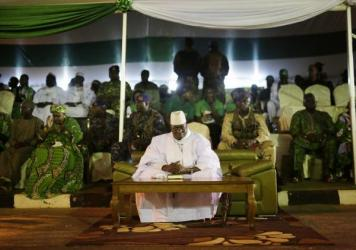Gambian President Yahya Jammeh sits during his final pre-election rally in November in Banjul, Gambia. He lost that vote to rival Adama Barrow but has refused to step down.