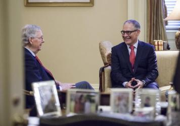 Senate Majority Leader Mitch McConnell, R-Ky., meets Jan. 6 with Environmental Protection Agency Administrator-designate Scott Pruitt, right, on Capitol Hill in Washington, D.C. Pruitt's confirmation hearing is scheduled for 10 a.m. ET on Wednesday.