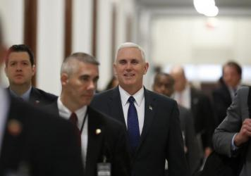 Vice President-elect Mike Pence walks through the halls of the Russell Senate Office Building on Capitol Hill on Tuesday.