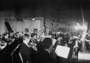 Paul McCartney conducts a 40-piece orchestra during recording sessions for <em>Sgt. Pepper's Lonely Hearts Club Band</em>.