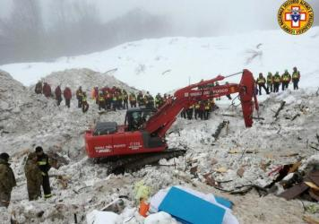 An excavator works at the site of the avalanche-buried Hotel Rigopiano, near Farindola, Italy.