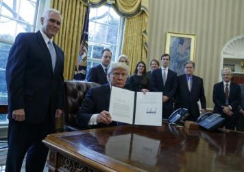 President Trump, accompanied by Vice President Pence and staff, signed multiple documents regarding two major oil pipelines in the U.S.