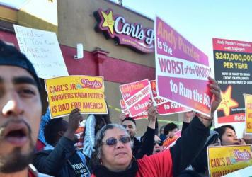 Fast-food workers in Los Angeles on Thursday protest against restaurant-chain mogul Andrew Puzder, who has been tapped as President Donald Trump's nominee for labor secretary.