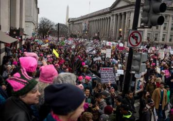 The Women's March passes by the U.S. Department of the Treasury in Washington, D.C.