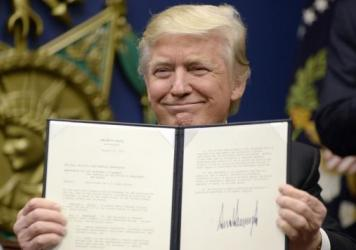 """President Trump signs two executive orders at the Department of Defenseon  Friday — calling for the """"great rebuilding"""" of the military and for """"extreme vetting"""" of visa seekers from seven countries."""