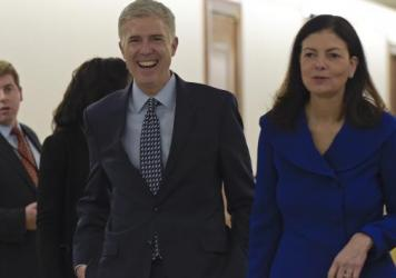 Supreme Court nominee Judge Neil Gorsuch, center, arrives with former New Hampshire Sen. Kelly Ayotte on Capitol Hill last week for a meeting with Sen. Bob Corker, R-Tenn. There are different kinds of conservative judges, from the pragmatist to the origi