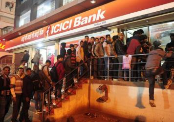 People line up to withdraw money from an ATM in Allahabad on Dec. 9. The government's removal of 500- and 1,000-rupee notes from circulation triggered a severe cash shortage.