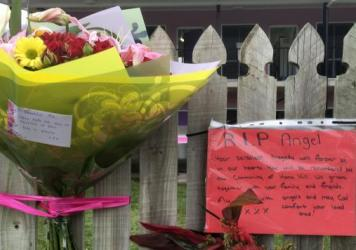 Flowers and well wishes are placed on a fence outside the hostel where British backpacker Mia Ayliffe-Chung, 21, was stabbed to death last year in a rural Australian community. A Frenchman was charged with her murder and that of another person, but while