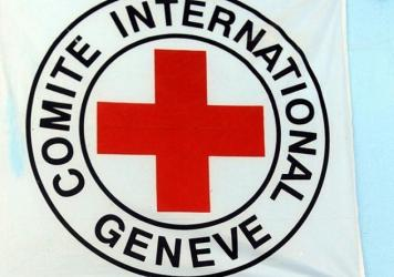 The International Committee of Red Cross emblem hangs on the wall of a hospital in Afghanistan's Herat province.