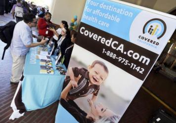 People sought out information about buying health insurance through the California exchange at Union Station in Los Angeles in 2013.