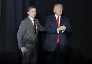 Michael Flynn (left) introduces Donald Trump at a campaign rally on Sept. 29, 2016, in Bedford, N.H. After less than a month on the job, Flynn resigned Monday as President Trump's national security adviser.