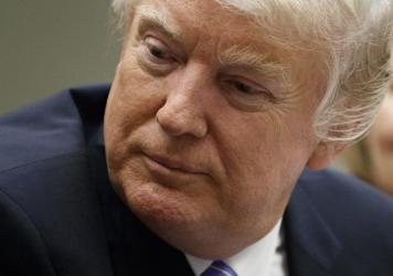 President Trump today at the White House. The New York attorney general says Democratic AGs are considering challenging state corporate charters of the president's businesses.