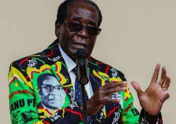 """Zimbabwe's President Robert Mugabe, who turns 93 on Tuesday, speaks at his party's annual conference in December, where he was endorsed as a candidate for the 2018 election. His wife said last week that even if he dies before the election, he should run """"as a corpse."""""""