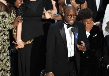 Barry Jenkins accepts the Academy Award for best picture for <em>Moonlight</em>.
