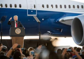 "President Trump addresses a crowd during the debut of the new Dreamliner 787 at Boeing's South Carolina facilities on Feb. 17 in North Charleston. Trump uses Boeing as an example of his ""America First"" policies, but the plane parts come from all over."