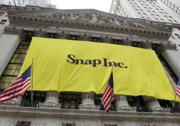 The banner for the Snap Inc. IPO is raised on the facade of the New York Stock Exchange. Snap Inc. is expected to start trading on the New York Stock Exchange on Thursday under the symbol SNAP.