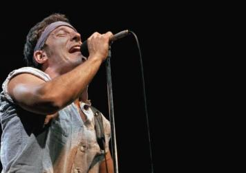 """Bruce Springsteen performs at Meadowlands Arena in New Jersey in August 1984, the same year his hit """"Glory Days"""" was released. It was an anthem for a generation looking back at the good, old days."""