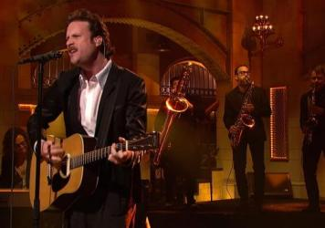 "Father John Misty opened his performance on Saturday Night Live with ""Total Entertainment Forever."""
