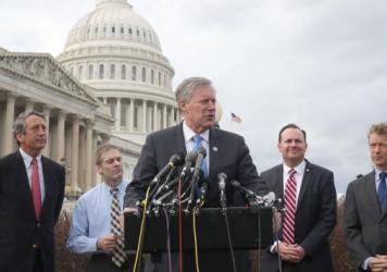Rep. Mark Meadows, R-N.C., chairman of the Freedom Caucus, speaks out against the GOP leadership's plan to repeal and replace the Affordable Care Act on Tuesday, flanked by fellow Republicans Rep. Mark Sanford of South Carolina, Rep. Jim Jordan of Ohio, Sen. Mike Lee of Utah and Sen. Rand Paul of Kentucky.