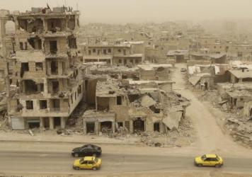 The Karm al-Jabal neighborhood of Aleppo, Syria, in a picture taken during a sandstorm Friday. A U.S. court has issued a temporary order that one Syrian family's asylum petition be processed regardless of President Trump's new travel ban.