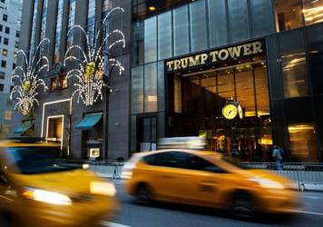 """Traffic flows past Trump Tower in New York in November 2016. The Trump administration wants more time to produce evidence that then-President Barack Obama ordered surveillance on Donald Trump during last year's election. Trump says his predecessor ordered his """"wires tapped"""" in Trump Tower."""
