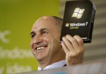 Chris Liddell, then CFO of Microsoft Corp., holds up a copy of the Windows 7 computer operating system during a rally to celebrate its release in October 2009.