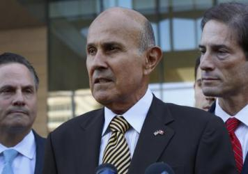 Ex-LA County Sheriff Lee Baca, with attorneys David Hochman (left) and Nathan Hochman, talks to the media as he leaves federal court in Los Angeles on Wednesday, after being convicted of obstructing an FBI corruption investigation of jails he ran and of