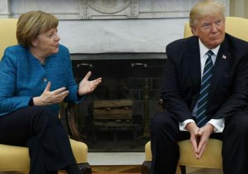 "President Donald Trump meets with German Chancellor Angela Merkel in the White House on Friday. ""It is much, much better to talk to one another and not about one another,"" Merkel said."