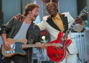"In this Sept. 2, 1995 file photo, Bruce Springsteen, left , and Chuck Berry laugh as they perform the Berry hit ""Johnny B. Goode"" at the Concert for the Rock and Roll Hall of Fame in Cleveland. Berry was the opening act of the concert."
