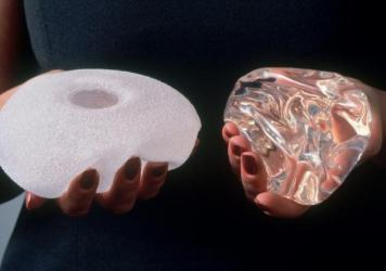 A textured breast implant, left, and a smooth breast implant.
