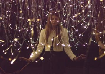 "Lydia Ainsworth performs ""Afterglow"" in the <em>Optic Obscura</em> installation during SXSW."