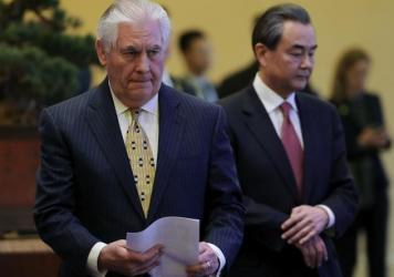 "Secretary of State Rex Tillerson has instructed consular officials to develop criteria to identify ""populations warranting increased scrutiny"" for visa applications. He's shown here last week in Beijing with Chinese Foreign Minister Wang Yi."