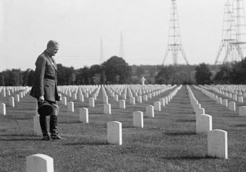 "Gen. John ""Black Jack"" Pershing visits Arlington National Cemetery in 1925. Pershing led the U.S. forces in World War I, the moment when the American military first displayed its might in a major foreign war. The U.S. military suffered heavy losses, but it also expanded dramatically, modernized and became more professional under Pershing's command."