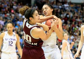 Gabby Williams of the Connecticut Huskies battles for the ball against Dominique Dillingham of the Mississippi State Lady Bulldogs in the first half Friday night during the semifinal round of the 2017 NCAA Women's Final Four in Dallas.