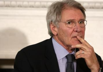 Actor Harrison Ford listens during a State Dining Room event April 2, 2013 at the White House in Washington, D.C.