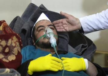 A Syrian man receives treatment following a suspected toxic chemical attack Tuesday in Khan Sheikhun, a rebel-held town in Syria's northwestern Idlib province. At least 58 people were killed, including a number of children.