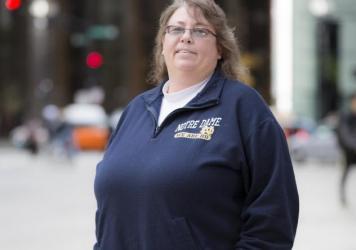 A federal appeals court ruled Tuesday that the 1964 Civil Rights Act protects LGBT employees from workplace discrimination, setting up a likely battle before the Supreme Court and gay rights advocates. Indiana teacher Kimberly Hively, shown here in 2015,