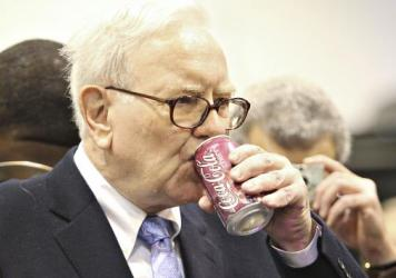 Warren Buffett, CEO of Berkshire Hathaway, drinks a Cherry Coca-Cola prior to the company's annual meeting in Omaha, Neb., in 2010.