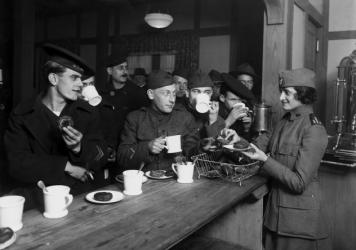 "GIs enjoy a cup of coffee during World War II. ""The American soldier became so closely identified with his coffee that G.I. Joe gave his name to the brew,"" according to coffee historian Mark Pendergrast."
