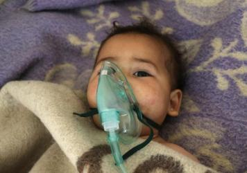 A Syrian child is treated at a hospital in the town of Maaret al-Noman after a suspected chemical attack on April 4.