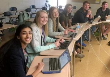 Students Gina Mathew (from left), Kali Poenitske, Maddie Baden, Trina Paul, Connor Balthazor and Patrick Sullivan at Pittsburg High School in Pittsburg, Kan. When reporters for the student newspaper there dug into the credentials offered by their new pri