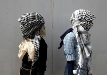 "Black-and-white keffiyeh like the one pictured above have long been associated with Yasser Arafat and the Palestinian resistance. This week, fast-fashion Brit emporium Top Shop used similar fabric for a ""scarf playsuit."""