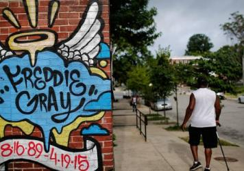 A mural dedicated to Freddie Gray was painted near the location where he was arrested in Baltimore, Md. A judge has approved a court-enforceable consent decree to overhaul the city's police department, after an investigation prompted by Gray's death.