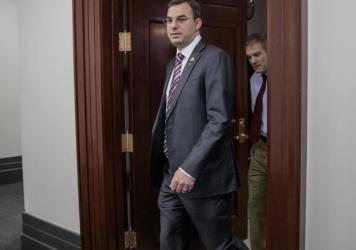 This March 28, 2017, photo shows Rep. Justin Amash, R-Mich., leaving a closed-door strategy session on Capitol Hill. A top aide to President Donald Trump urged the primary defeat of Amash in a tweet.