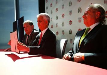 U.S. Soccer Federation President Sunil Gulati (center), Canadian CONCACAF President Victor Montagliani (left) and Mexican Football Federation President Decio De Maria present their unified bid for the 2026 World Cup at a news conference in New York City
