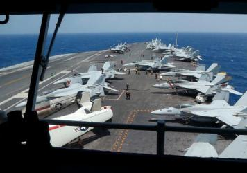 "Fighter jets on board the U.S. Navy aircraft carrier USS Carl Vinson off the disputed South China Sea on Mar. 3. The carrier was recently ordered to ""report on station in the Western Pacific Ocean,"" instead of sailing for Australia as planned."