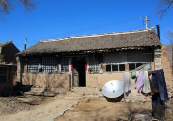 Ming lives in this mud brick home, three miles outside Beijing city limits.