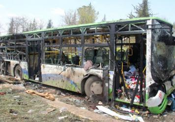 A picture taken on April 16, 2017, shows the damage a day after a suicide car bombing attack in Rashidin, west of Aleppo, targeted buses carrying Syrians evacuated from two besieged government-held towns of Fuaa and Kafraya.