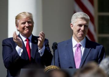 President Trump introduces Supreme Court Justice Neil Gorsuch in the Rose Garden after Gorsuch's swearing-in on April 10.